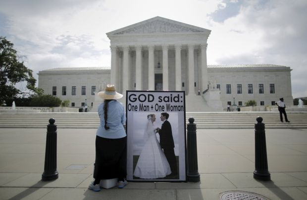 An opponent of same-sex marriage protests outside the U.S. Supreme Court in Washington June 18.  (CNS photo/Carlos Barria, Reuters)