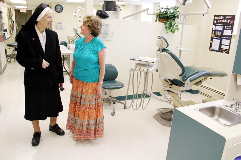 Sister Mary Cecilia Jurasinski, O.S.B.M., and Dr. Virginia Saunders, director and professor for the dental hygiene program at Manor College, review the dental health center. (Sarah Webb)