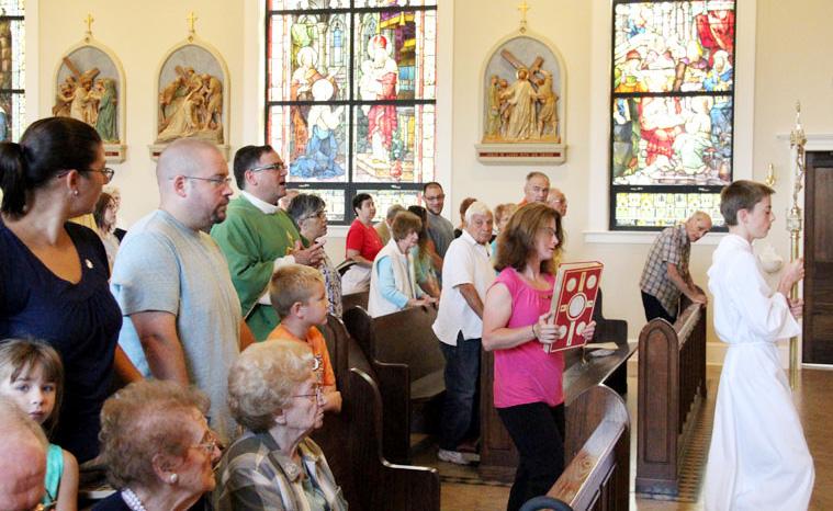Fr Joseph C. Bordonaro, lector Kathleen Furlong, server Matthew Quigley
