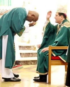 BIshop McIntyre blesses Deacon Bill Bradley before he reads the Gospel.