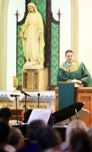 Fr Tom Whittingham address the congregation after mass