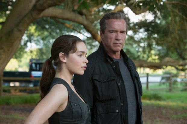 """Emilia Clarke and Arnold Schwarzenegger star in a scene from the movie """"Terminator: Genisys."""" (CNS photo/Paramount)"""