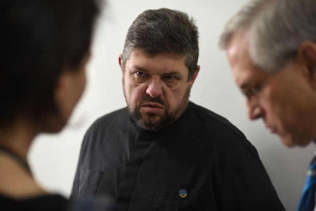 Ukrainian Catholic Father Tykhon Kulbaka , who was held in pro-Russian separatists' captivity for 12 days, speaks with a U.S. delegation June 22 in Lviv. The priest recalled his 12 days in captivity and said the emotional captivity that followed was worse than his physical captivity. (CNS photo/Markian Lyseiko, EPA)