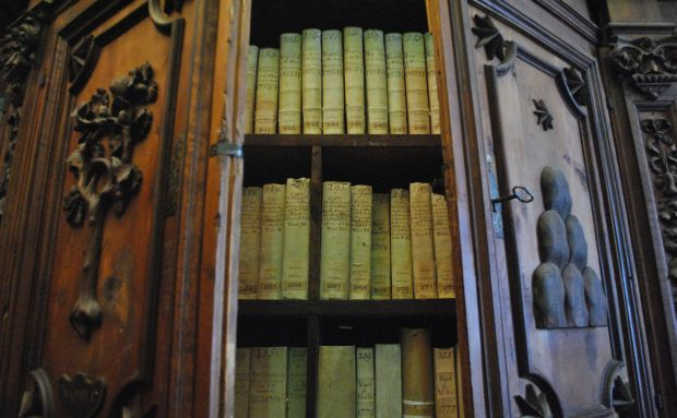 Books are pictured in a cabinet in the Vatican Secret Archives. Pope Leo XIII founded the Vatican School of Paleography, Diplomatics and Archive Administration in 1884, just a few years after he opened the archives to the world's scholars. (CNS photo/Vatican Secret Archives)