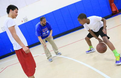 The grant to Visitation Community Center will support the center's youth programs, such as coaching basketball and other skills to young people. (Sarah Webb)