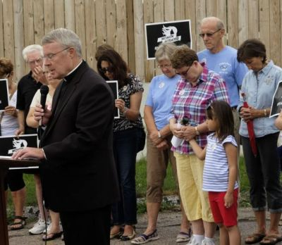 """Bishop R. Walker Nickless of Sioux City, Iowa, speaks during a """"Women Betrayed"""" rally in Sioux City July 28. Demonstrations were held in 65 cities across the country calling for an end to federal funding of Planned Parenthood (CNS photo/Jerry L. Mennenga, The Catholic Globe)"""