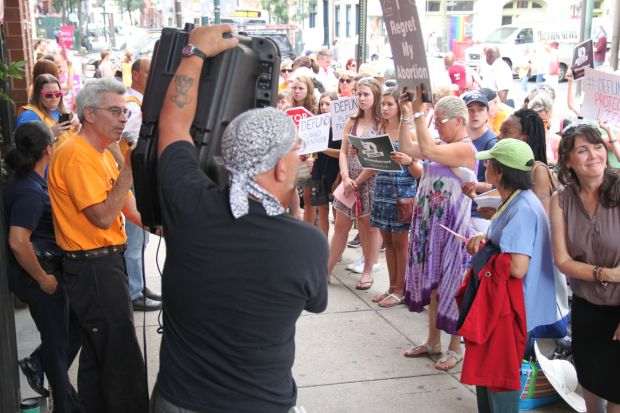 """About 200 people joined a """"Women Betrayed"""" rally to witness for life near an abortion facility July 28 in center city Philadelphia."""