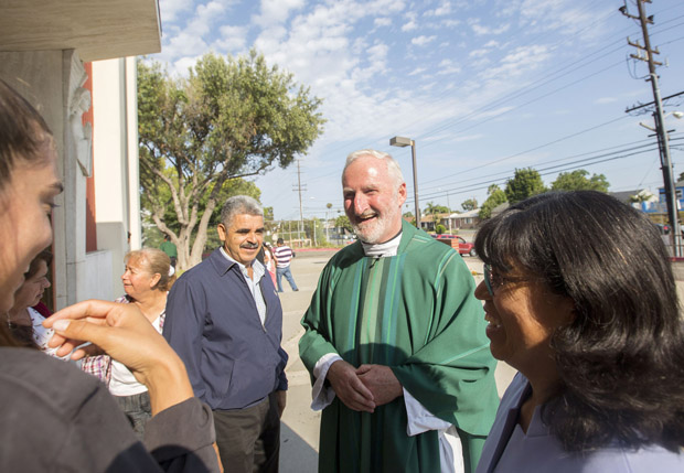 Msgr. David G. O'Connell is pictured speaking with parishioners outside St. Frances X. Cabrini Church in Los Angeles July 19. Pope Francis has named Msgr. O'Connell an auxiliary bishop for the Archdiocese of Los Angeles. Msgr. O'Connell, 61, is a native of County Cork, Ireland. (CNS photo/John Rueda, The Tidings)