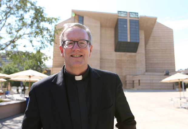 Father Robert Barron is pictured in front of the Cathedral of Our Lady of the Angels in Los Angeles July 20. Pope Francis has named Father Barron an auxiliary bishop for the Archdiocese of Los Angeles. Father Barron, 55, is a native of Chicago who has served as rector of Mundelein Seminary and president of the University of St. Mary of the Lake, also in Mundelein, Ill., since 2012. (CNS photo/J.D. Long-Garcia, The Tidings)