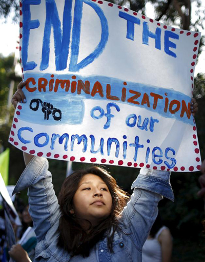 An immigration advocate demonstrates in Los Angeles July 10. A federal judge ruled July 24 that family detention violates long-standing policy that resulted from a 1997 settlement in a Supreme Court case over holding immigrant youth. (CNS photo/Lucy Nicholson, Reuters)