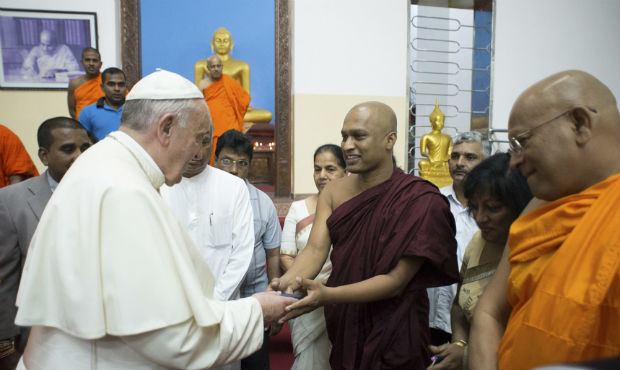 Pope Francis greets Buddhist monks in Colombo, Sri Lanka, Jan. 14 during an unscheduled visit to a Buddhist temple at his request, responding to an invitation he had received the previous day from the temple's head priest. (CNS photo/L'Osservatore Romano via Reuters)