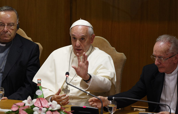 Pope Francis addresses mayors from around the world at a workshop on climate change and human trafficking in the synod hall at the Vatican July 21. Also pictured are Cardinal Francesco Montenegro of Agrigento, Italy, left, and Cardinal Claudio Hummes, former prefect of the Congregation for the Clergy. (CNS photo/Paul Haring)