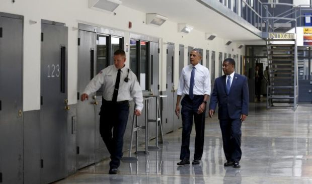 U.S. President Barack Obama visits El Reno Federal Correctional Institution outside Oklahoma City July 16 with  Charles Samuels, bureau of prisons director, right, and a corrections officer. Obama is the first sitting president to visit a federal prison. (CNS photo/Kevin Lamarque, Reuters)