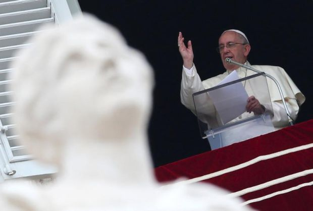 Pope Francis blesses the faithful during his Angelus address on the feast of the Assumption at Vatican Aug. 15. (CNS photo/Alessandro Bianchi, Reuters)