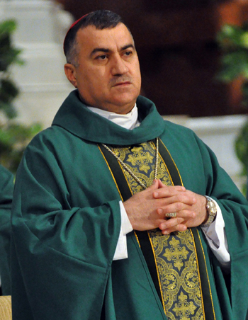Chaldean Catholic Archbishop Bashar Warda of Irbil, Iraq, concelebrates an Aug. 23 Mass at SS. Peter and Paul Cathedral in Indianapolis. The archbishop visited several U.S. cities and discussed his experience with the flood of Christian refugees to Irbil following the Islamic State's capture of Mosul and the Ninevah Plain . (CNS photo/Sean Gallagher, The Criterion)