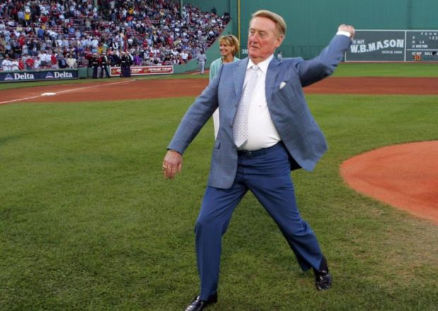 Los Angeles Dodgers Hall of Fame announcer Vin Scully throws out the ceremonial first pitch in early June prior to the first game ever between the Los Angeles Dodgers and the Boston Red Sox at Fenway Park in Boston. Scully will likely retire after the 2016 season, his 67th announcing games for the franchise. (CNS photo/Jon Soohoo, EPA)