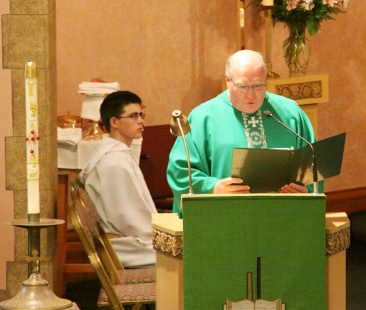 Reading the proclamation from Archbishop Chaput was Fr. Michael Fitzpatrick
