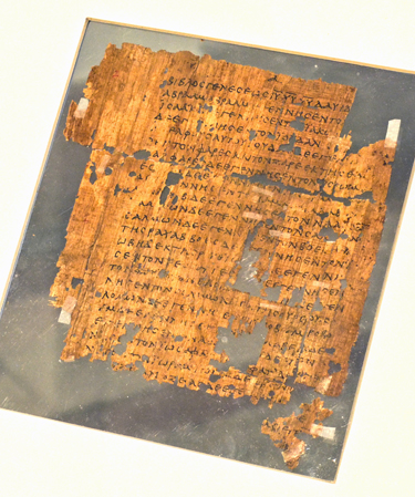 One of the world's oldest fragments of the Gospel of St. Matthew, written on papyrus and dating to the third century CE, was once part of a codex (book). This fragment, written in ancient Greek, contains the beginning of the Gospel of Matthew (Mt. 1:1-9, 12, 14-20). (Photo by Penn Museum)
