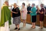 Fr. Jason Kulczynski is greeted by parish representitives