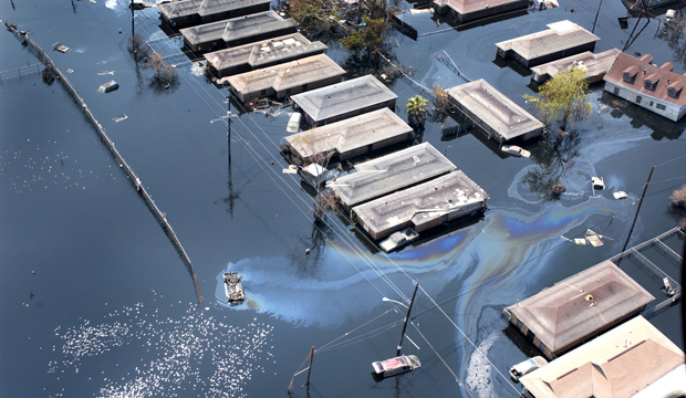 Homes are seen surrounded by floodwaters and oil slicks in St. Bernard Parish, south of New Orleans, after Hurricane Katrina swept through the area in 2005. (CNS photo/Frank J. Methe, Clarion Herald)
