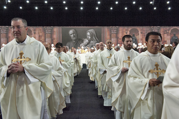 Some of the more than 100 priests, along with more than a hundred bishops, archbishops and cardinals, exit the exhibition hall at the Pennsylvania Convention Center Aug. 4 at the conclusion of the opening Mass of the Knights of Columbus' annual convention. (Kaitlyn Landgraf)