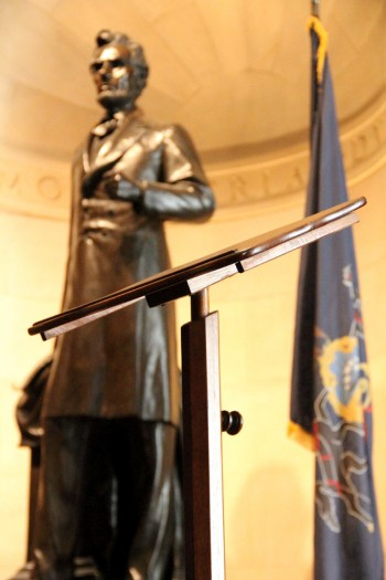 The lectern that President Abraham Lincoln used to deliver the Gettysburg Address almost 152 years ago stands at the Union League of Philadelphia before a statue of Lincoln. Pope Francis will use same lectern when he speaks at Independence Hall Sept. 26 during his two-day visit to Philadelphia this fall. (Sarah Webb)