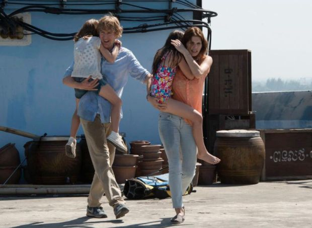 "Owen Wilson and Lake Bell star in a scene from the movie ""No Escape."" (CNS photo/Weinstein)"