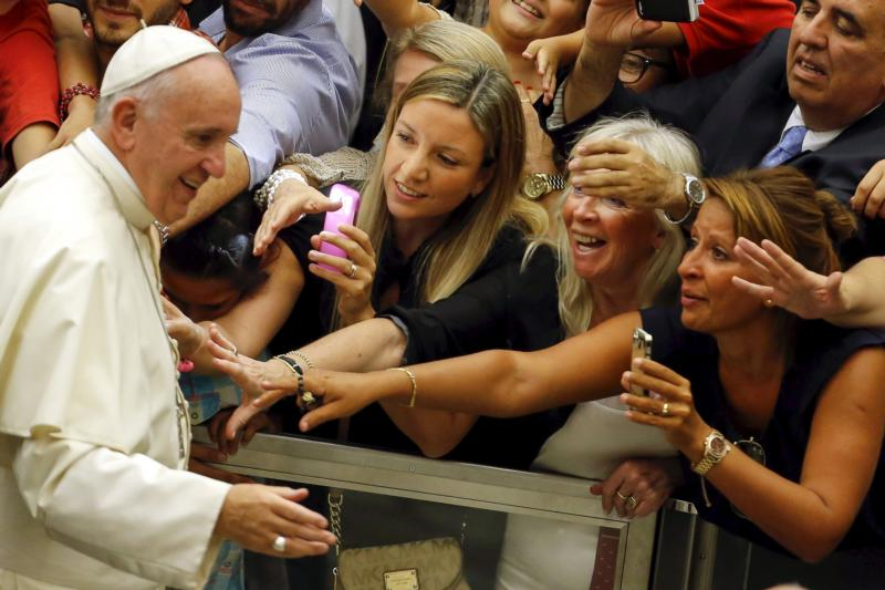 People react as Pope Francis arrives to lead his weekly audience in Paul VI hall at the Vatican Aug. 5. (CNS photo/Giampiero Sposito, Reuters)