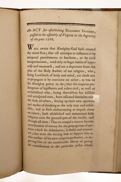 A book citing Virginia's religious freedom provision from 1786 is part of the National Constitution Center's exhibit on the subject.