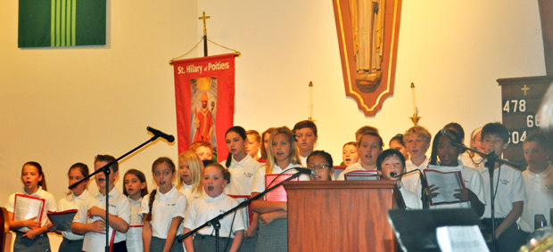 Students of St. Hilary School in Rydal, Montgomery County, sing during a recent Mass at the church. The school received a grant to purchase a set of new hymnals with music aimed at youth and young adults.