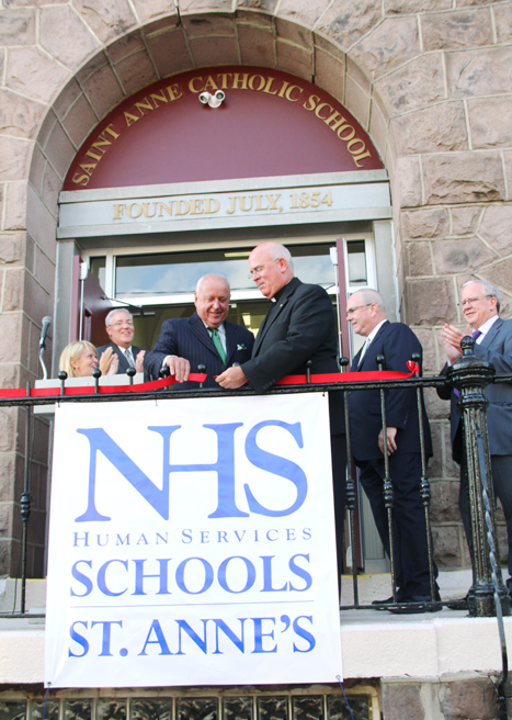 Following its 2011 closure as a Catholic parish school, the venerable St. Anne School in Philadelphia's Port Richmond section gets new life this September as it reopens as a school for children with varying levels of autism. John Egan and Father Edward Brady cut the ribbon signifying the opening of the new school.(Sarah Webb)