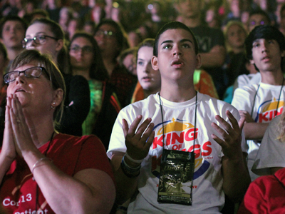 Participants and youth leaders pray during Mass Aug. 8 at the Steubenville NYC youth conference. (CNS photo/Gregory A. Shemitz)