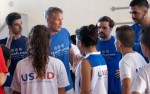 Philadelphia 76ers Coach Brett Brown gives pointers to Arab and Israeli youth during a July 30 basketball clinic sponsored by PeacePlayers International in  Jerusalem.  (CNS photo/Mary Knight)