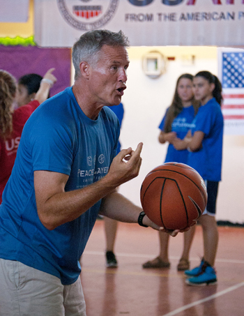 Philadelphia 76ers Coach Brett Brown gives pointers to Arab and Israeli youth in a weeklong program that teaches tolerance and instills tools for peacemaking through basketball. (CNS photo/Mary Knight)