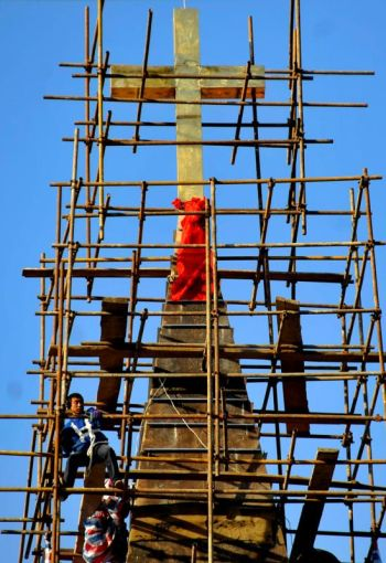 In this 2010 file photo, a worker climbs scaffolding surrounding a church in Qingdao, China. Two excommunicated bishops in China have ordained priests in separate ceremonies during the past two months. (CNS photo/Wu Hong, EPA)