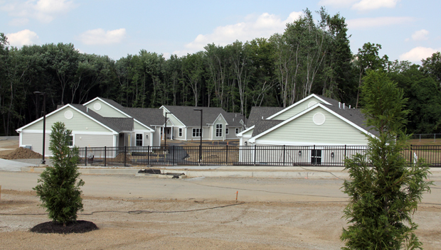 The new complex of three cottages called the Communities of Don Guanella near completion on a property adjacent to the former Don Guanella Village campus and nearby Cardinal O'Hara High School. The cottages will house 16 men, former DGV residents. (Sarah Webb)