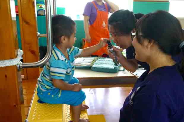 In this undated photo, Dr. Kelly Kao and Judy Chang engage a young patient at Qishan Child Early Intervention and Development Center in Kaohsiung City, Taiwan. (CNS photo/courtesy Catholic San Francisco)