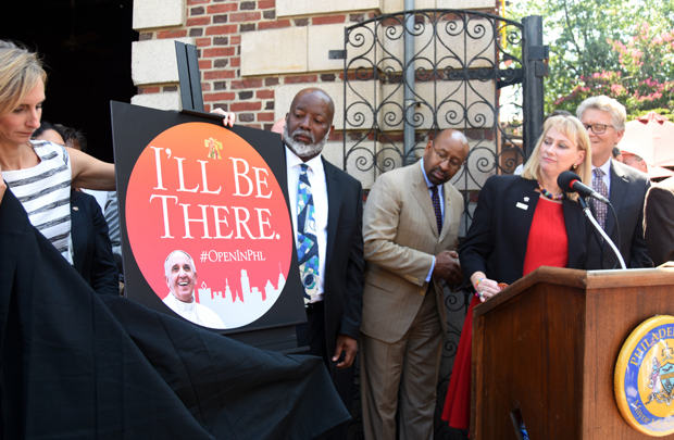 "Donna Crilley Farrell, Mayor Michael Nutter and other officials unveil the ""I'll Be There"" campaign promoting the World Meeting of Families and visit of Pope Francis to Philadelphia for the thousands of visitors coming to the city in September. The campaign was announced Aug. 26 at Jack's Firehouse in the city's Fairmount section, near the Philadelphia Museum of Art where the pope will celebrate Mass Sunday, Sept. 27. (Photos by SabinaShoots)"