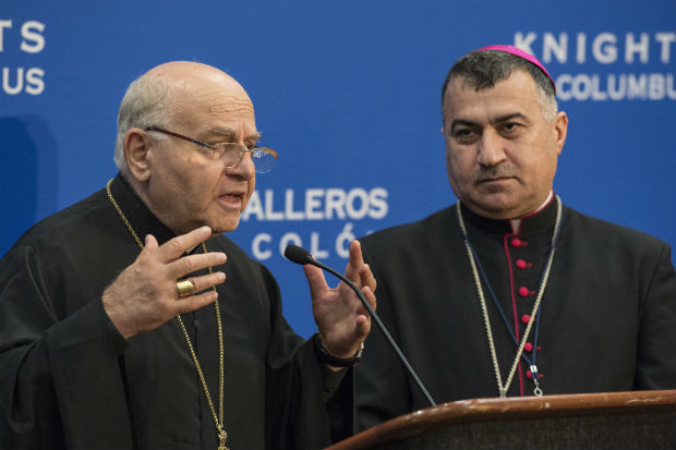 Melkite Archbishop Jean-Clement Jeanbart of Aleppo, Syria (left) and  Chaldean Archbishop Bashar Matti Warda of Erbil, Iraq, speak at a press conference Aug. 4 during the Knights of Columbus' 133rd Supreme Convention in Philadelphia Aug. 4-6. (Kaitlyn Landgraf)