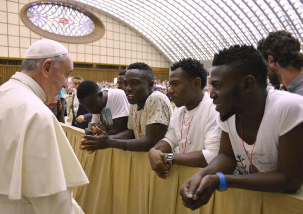 Pope Francis meets a group of Nigerian refugees at the Vatican Aug. 12. The pope will address the U.S. Congress and the U.N. General Assembly during his September U.S. visit and will discuss the idea of one human family and shared responsibility for others and the world. (CNS photo/L'Osservatore Romano via Reuters)