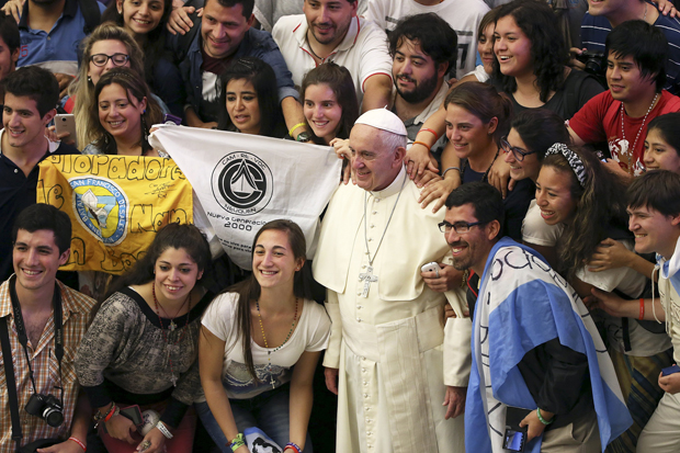 Pope Francis poses for a photo with Argentine youths during his weekly audience in Paul VI hall at the Vatican Aug. 19. (CNS photo/Alessandro Bianchi, Reuters)