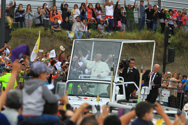 Pope Francis greets the crowd from his popemobile, a Jeep Wrangler, as he arrives in Quito, Ecuador, July 5. The pontiff will use the same model during his visit to the United States in September. (CNS photo/Robert Puglla, EPA)