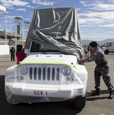 A police officer in Quito, Ecuador, June 30 covers the popemobile used by Pope Francis during his July 5-8 visit to the country. (CNS photo/Guillermo Granja, Reuters)