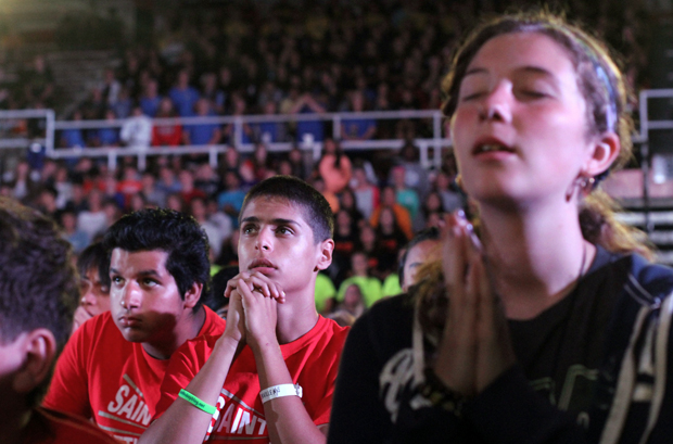 Participants pray during eucharistic adoration Aug. 8 at the Steubenville NYC youth conference at St. John's University. More than 1.800 teenagers attended the Aug. 7-9 event. (CNS photo/Gregory A. Shemitz)