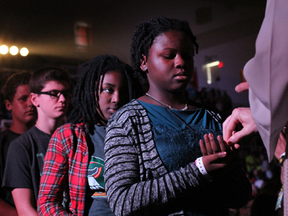 A young woman receives Communion during Mass Aug. 8 at the Steubenville NYC youth conference at St. John's University in the New York borough of Queens. (CNS photo/Gregory A. Shemitz)