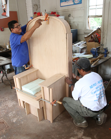 Day laborers Francisco Santamaria, an immigrant from Nicaragua, and Fausto Hernandez, an immigrant from the Dominican Republic, work Aug. 6 on a chair that is being constructed for Pope Francis in Port Chester, N.Y. The chair will be used by the pope when he celebrates Mass at Madison Square Garden Sept. 25 in New York City. (CNS photo/Gregory A. Shemitz) See PAPALTRIP-ALTAR-AMBO Aug. 10, 2015.