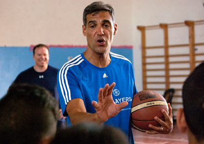 Villanova University Coach Jay Wright gives pointers to Arab and Israeli youth during a July 30 basketball clinic, followed by a game with Arab, Israeli and American youth participating. (CNS photo/Mary Knight)