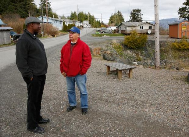 African Father Jean Paulin Lockulu, known as Father J.P. to his American parishioners, talks with a neighbor in Klawock, Alaska. Born and raised in the Congo, Father Jean was a religious missionary priest before joining the Diocese of Juneau in 2002. (CNS photo/Nancy Wiechec)