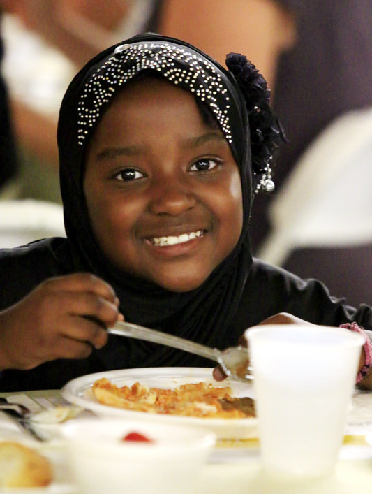 Zharae Henry enjoys her pasta prepared by students from Mercy Vocational High School