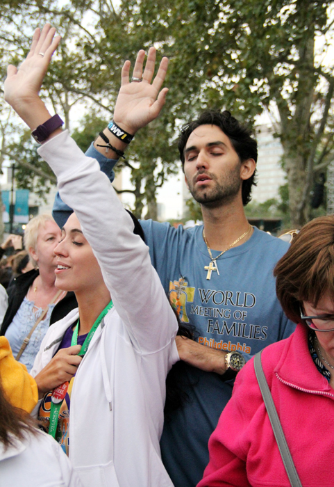 Anna Candeloro and Anthony Scafidi from Blackwood NJ praise the Lord during the Festival of Families. (Sarah Webb)